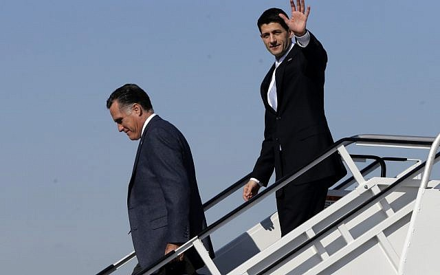 Republican presidential candidate, former Massachusetts Gov. Mitt Romney, followed by his vice presidential running mate, Rep. Paul Ryan, R-Wis., walk off Romney's plane in Cleveland, Ohio on November 6. (photo credit: AP/Charles Dharapak)