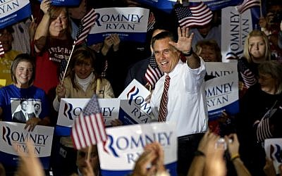 Republican presidential candidate, former Massachusetts Gov. Mitt Romney waves as he takes the stage for a campaign event at a window and door factory, Thursday, Nov. 1, 2012, in Roanoke, Va. (photo credit: David Goldman/AP)