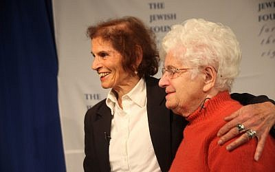 Shoshana Golan, left, a Holocaust survivor who changed her name from Rozia Beiman, reunites in New York with Wladyslawa Dudziak, a Pole who passed her off as a family member during the Holocaust. (Chavie Lieber/JTA)