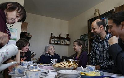 From left: Luiza Rozina, 78, Daniil Rozin, 11, Geda Rozina, 100, Maya Rozina, 8, Mark Rozin, 47, Lev Rozin, 24, drink tea at their apartment in Moscow. The four generations of Zimanenko- Rozin's family embody the history of Jews in Russia over the past century, from the restrictions of czarist times to the revival of Jewish culture in Russia today. (AP Photo/Sergey Ponomarev)