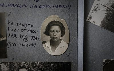 A photograph of Geda Rozina, now 100, in a family photo album in Moscow. (AP Photo/Sergey Ponomarev)