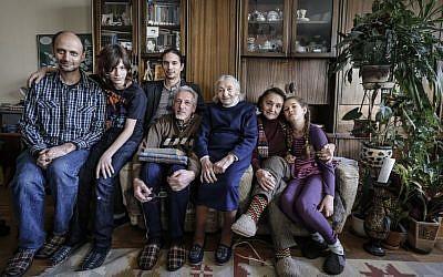 Mark Rozin, 47, Daniil Rozin, 11, Lev Rozin, 24, Anatoly Rozin, 78, Geda Zimanenko, 100, Luiza Rozina, 78, Maya Rozina, 8 pose in their Moscow apartment. (AP Photo/Sergey Ponomarev)