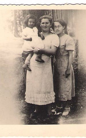 Shoshana Golan's mother, Sara Beiman, holds her daughter just before entrusting her with the Dudziak family. Sara presumably died in Majdanek. (Jewish Foundation for the Righteous via JTA)
