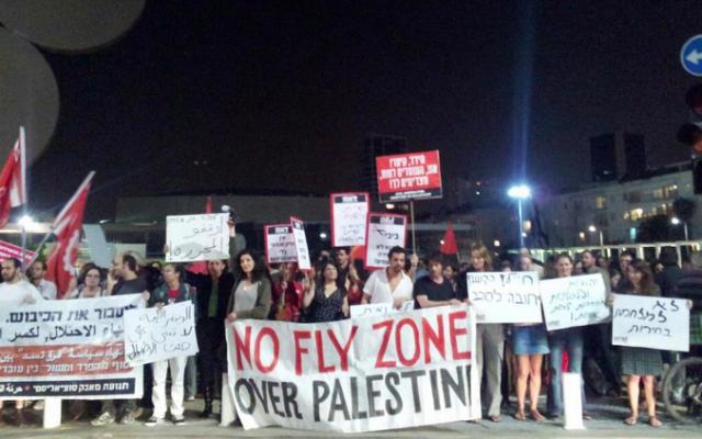 Rallying against Pillar of Defense in Tel Aviv. (photo credit: Yuval Ben-Ami)