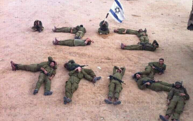 IDF soldiers using their bodies to spell 'Bibi [is a] loser,' November 22, 2012. (photo credit: screen capture/Facebook)