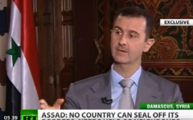 Syrian President Bashar Assad in an interview with Russia Today in 2012 (file photo credit: screenshot from YouTube, Russia Today)