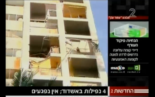 Screenshot of a building in the southern Israeli city of Ashdod that suffered a direct hit from a Gaza rocket on Saturday (photo credit: courtesy Channel 2 News)