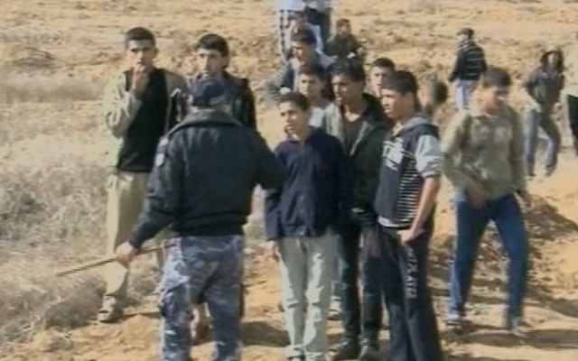 Hamas security forces stationed along the Israeli-Gaza border on Saturday. (photo credit: image capture from Channel 2)