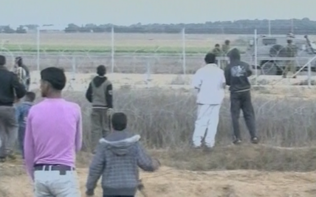 Gaza residents approaching the Israeli border fence, in November 2012. (photo credit: image capture from Channel 2)