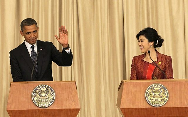 US President Barack Obama, left, and Thai Prime Minister Yingluck Shinawatra hold a joint press conference at the Government House in Bangkok, Thailand, Sunday, Nov. 18, 2012. (photo credit: Sakchai Lalit/AP)