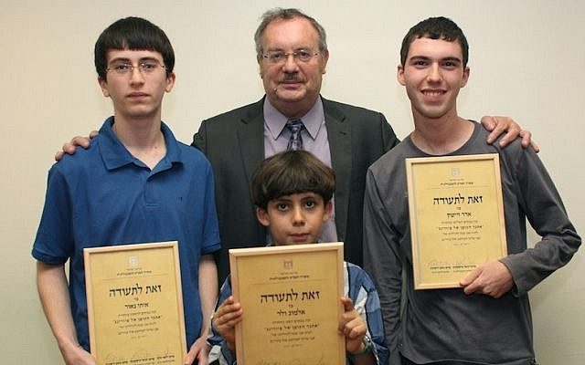 Education Minister Daniel Hershkowitz (center rear) with the winners of the Turing code contest (left to right) Itay Naor, Almog Veled, and Adar Zeitek (photo credit: Courtesy)