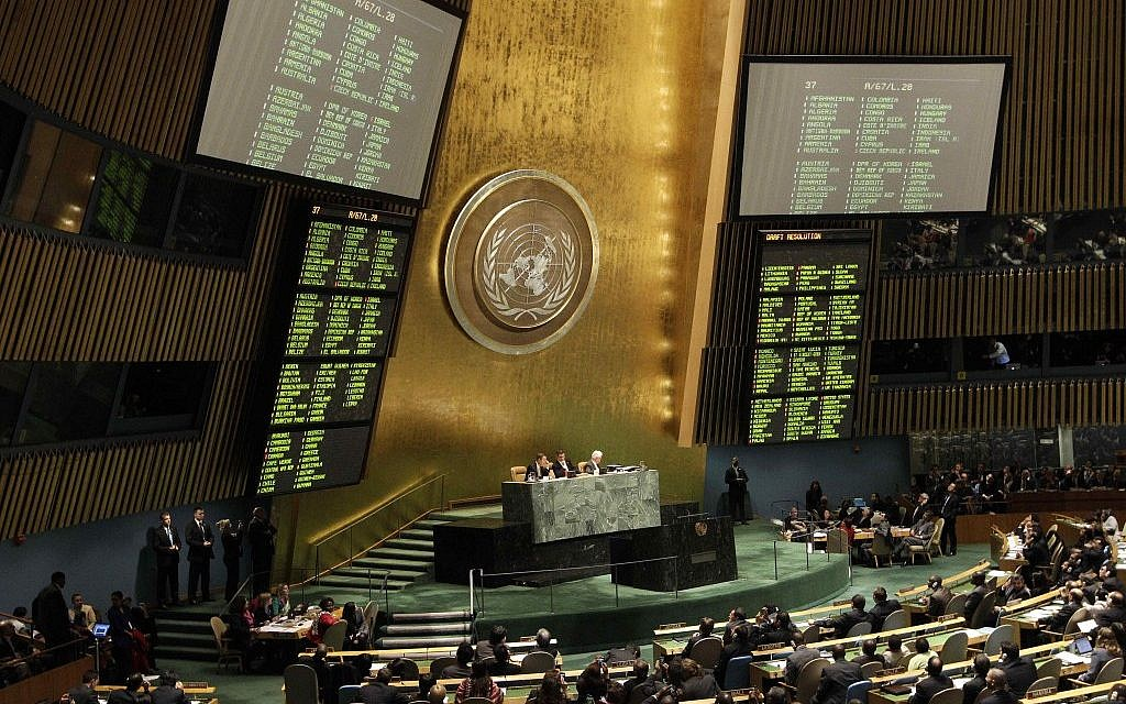 The results of a draft resolution on Palestinian status are posted in the United Nations headquarters, Thursday, November 29 (photo credit: AP/Kathy Willens)