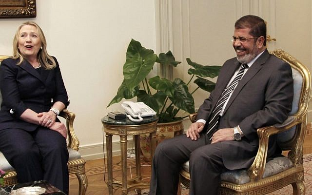US Secretary of State Hilary Rodham Clinton and Egyptian President Mohammed Morsi meet at the presidential palace in Cairo, Egypt, on July 14, 2012. (Photo credit: Maya Alleruzzo/AP)