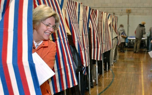 Democratic candidate for US Senate Elizabeth Warren, left, emerges from the polling booth as she votes in Cambridge, Massaschusetts on Election Day. (photo credit: AP/Josh Reynolds)
