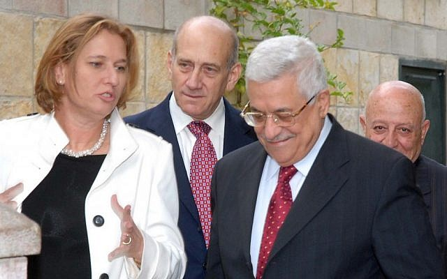 Then-foreign minister Tzipi Livni, then-prime minister Ehud Olmert, Palestinian Authority President Mahmoud Abbas and Palestinian negotiator Ahmed Qurei, during a meeting in Jerusalem in November, 2007 (photo credit: Moshe Milner/GPO/Flash90)