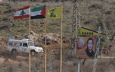 Lebanese, Palestinian and Hezbollah flags on the northern side of Israel's border with Lebanon. (Hamad Almakt/Flash90/File)
