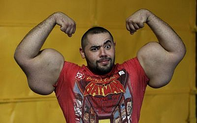 Egyptian Body builder Moustafa Ismail poses during his daily workout at World Gym in Milford, Mass., on Friday, November 16, 2012 (photo credit: AP Photo/Stephan Savoia)