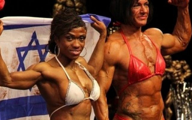 Alana Shipp (left) onstage after winning third place in the Ms. Physique title in Hamburg, Germany (Courtesy Alana Shipp)