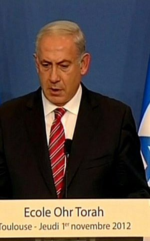 Prime Minister Benjamin Netanyahu addresses a attendees of a memorial ceremony for the victims of the Toulouse shooting in France, Thursday (photo credit: Channel 10 screen capture)