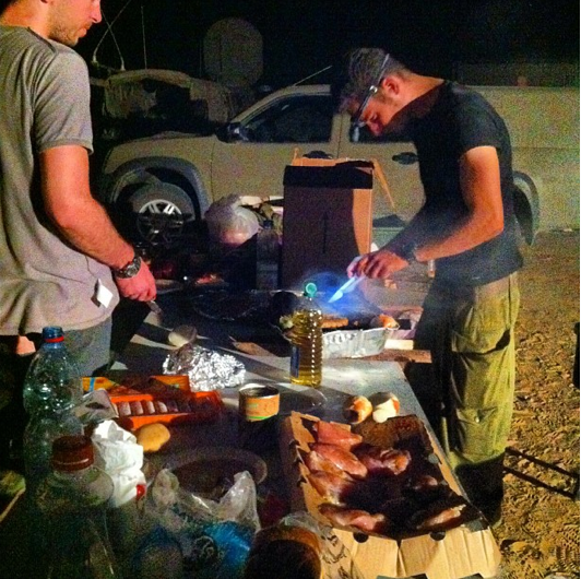 Preparing dinner, in the field (photo credit David Yeshayahu/Instagram)