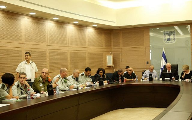 Knesset members and IDF officers attend a Foreign Affairs and Defense committee meeting in the Israeli parliament on Thursday, November 15 (photo credit: Miriam Alster/Flash90)