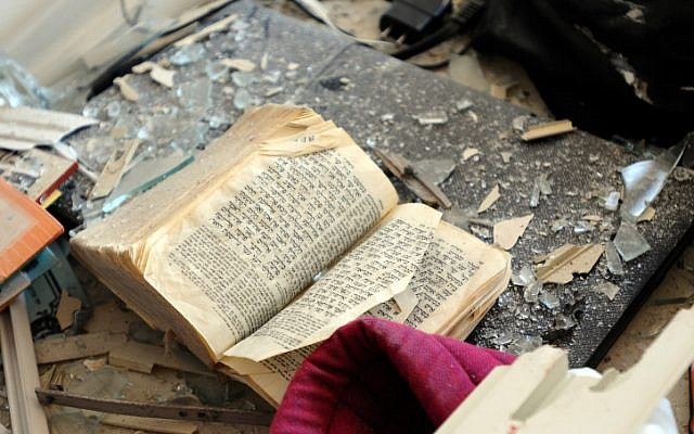 A Bible covered with debris in a Kiryat Malachi apartment in which three people were killed from a rocket attack on Thursday (photo credit: Yossi Zeliger/Flash90)