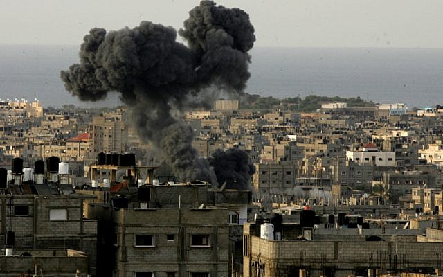 Smoke billows from the site of an Israeli airstrike in the southern Gaza Strip on November 16, 2012. (photo credit: Abed Rahim Khatib/Flash 90)