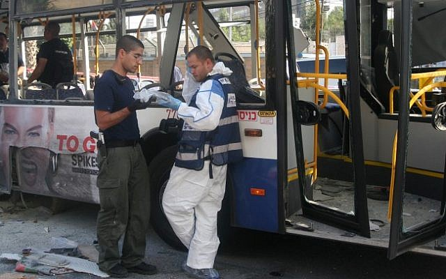 Police and rescue personnel at the scene of the Wednesday, November 21 bus bombing in Tel Aviv (photo credit: Roni Schutzer/Flash90)