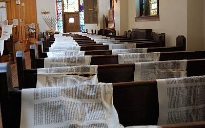 At Mazel Academy in Brooklyn, Torah scrolls were unrolled to dry after being damaged by floodwaters from Hurricane Sandy (photo credit: Ben Harris/JTA)