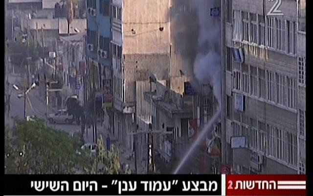 Smoke rises from the Gaza media building attacked by Israel on Monday (photo credit: screen capture/Channel 2)
