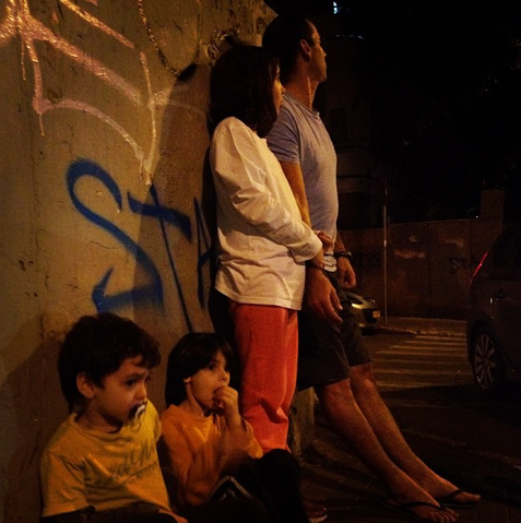 A family waiting out a siren in Tel Aviv (Courtesy Nemera/Instagram)