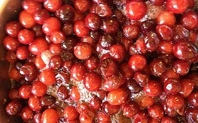 Cranberries bubbling away on the stove (photo credit: Jessica Steinberg/Times of Israel)