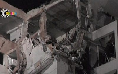 A building in Rishon that sustained heavy damage from a rocket attack on Tuesday (photo credit: Channel 10 screen capture)