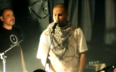 SAZ draped in a keffiyeh, a potent Palestinian symbol (Courtesy Youtube screengrab)