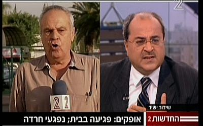 Arab MK Ahmed Tibi lets loose on Channel 2's military analyst Roni Daniel (image capture/Channel 2 News)