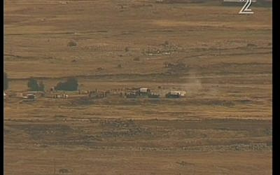 Syrian soldiers firing artillery shells near Israel's border on Monday. (Screenshot/ Channel 2)