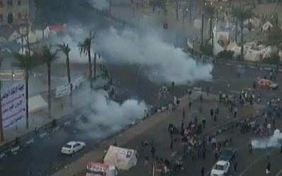 Police dispersing the crowd with tear gas in Tahrir Square, Cairo, on Wednesday morning (photo credit: Youtube screen capture)