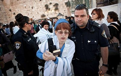 A woman arrested for wearing a prayer shawl at the Western Wall on Thursday (photo credit: courtesy Woman of the Wall)