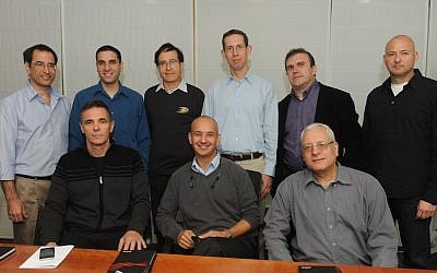 Featured in the photo are the heads of start-ups acquired by Broadcom in Israel over the last decade, along with Dr. Shlomo Markel (back row, third from left)  (Photo credit: Courtesy)