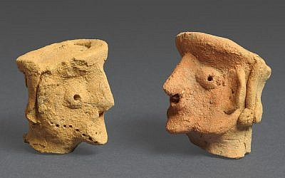 Ancient figurines of people found at Tel Motza (photo credit: Clara Amit/courtesy of IAA)