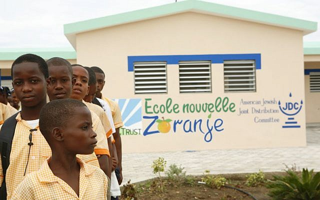 Children from the Haitian town of Zoranje stand outside a school built with part of the $16.2 million donated by Jewish organizations after the deadly 2010 earthquake. (Courtesy of the American Jewish Joint Distribution Committee via JTA)