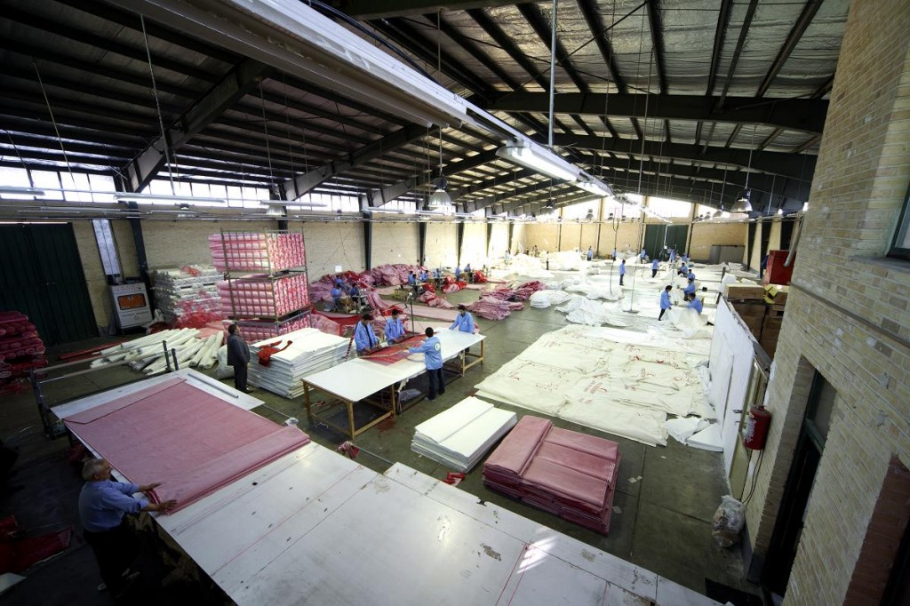 An Iranian tent factory. (photo credit CC BY-SA Bob McCaffrey & Tehran says country is benefiting from sanctions against it | The ...