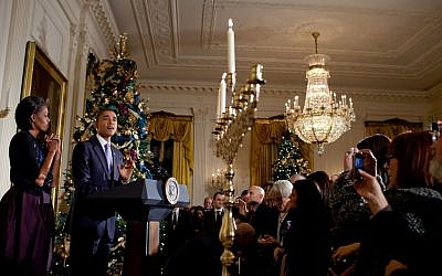 Barack Obama and his wife Michelle at a Hanukkah menorah lighting ceremony in the White House in 2010. (photo credit: Pete Souza/White House via Flickr)