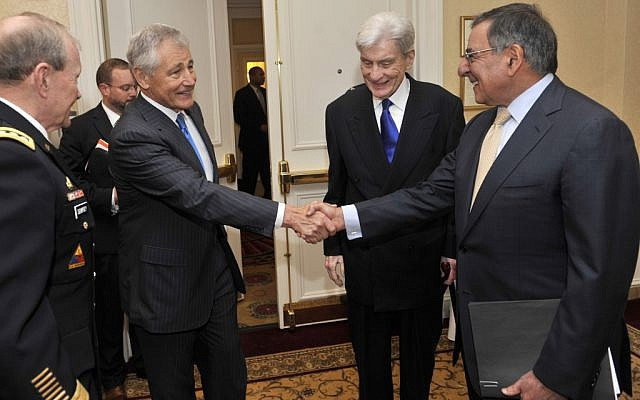 Former senator Chuck Hagel (left) shakes hands with Secretary of Defense Leon E. Panetta in May 2012. (photo credit: CC BY Glenn Fawcett, DoD, Flickr)