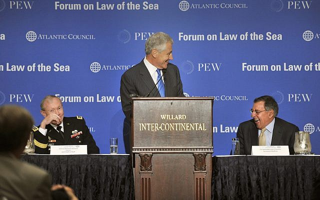 Chuck Hagel, at podium, speaking at a conference in May. (photo credit: Glenn Fawcett/Department of Defense)