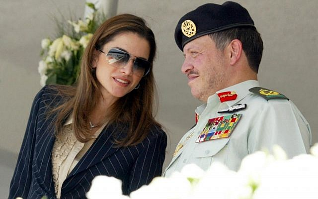 Jordan's King Abdullah II sits with his wife, Queen Rania, at a celebration commemorating the early 20th century's Arab revolution, Amman, June 10, 2002 (photo: AP/Royal Palace, Yousef Allan)
