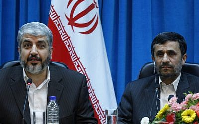 Palestinian Hamas leader Khaled Mashaal, left, speaks, as Iranian President Mahmoud Ahmadinejad, listens during the International Conference on National and Islamic Unification of Palestine Future in Tehran, Iran, Sunday, Feb. 28, 2010 (photo credit: Vahid Salemi/AP)