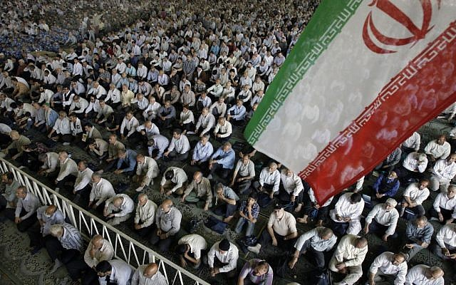 Illustrative photo of Iranian worshippers listening to a sermon during Friday prayers in July 2012. (AP/Vahid Salemi)