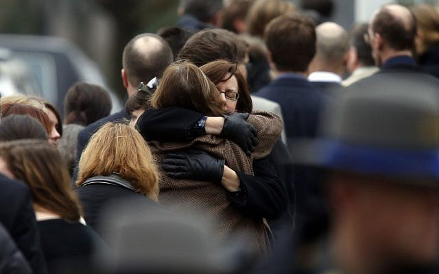 Mourners arrive at a funeral service for 6-year-old Noah Pozner on Monday in Fairfield, Conn. (photo credit: AP/Jason DeCrow)