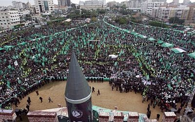 A large model of a M75 long-range missile is seen as hundreds of thousands attend a rally to commemorate the 25th anniversary of the Hamas terrorist organization in Gaza city on Saturday (photo credit: AP/Hatem Moussa)